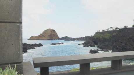 View of the rocks and the sea from the boardwalk