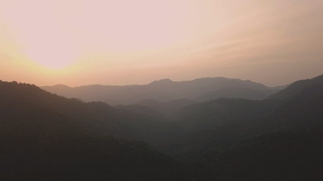 View to the horizon of a mountain range in a beautiful sunset