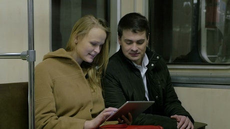 Viewing a tablet on the train