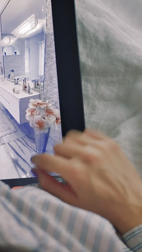 Viewing images of luxury houses on a tablet