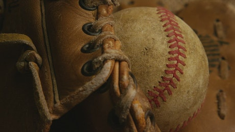 Vintage baseball ball in the glove