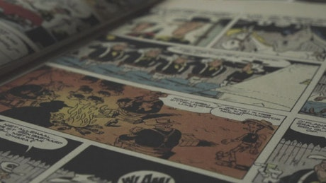 Vintage comic book open in a table