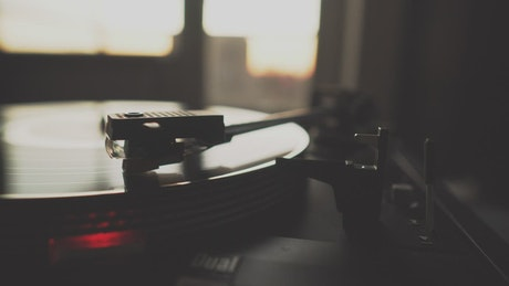Vintage turntable playing music