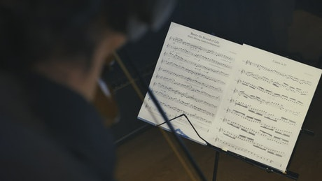 Violinist playing in a studio following a score