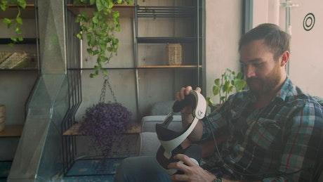 Virtual reality glasses worn by a man