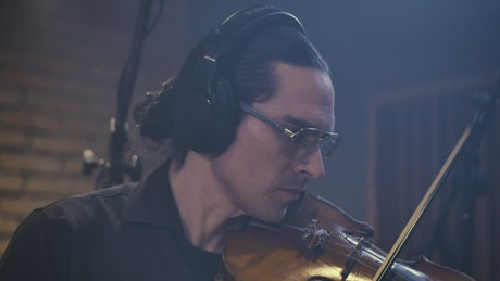 Virtuous violinist playing in a studio