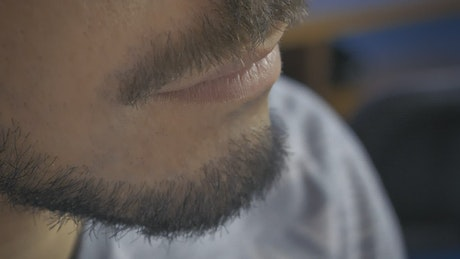 Vlogger testing a lapel mic on his neck