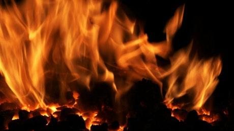 Volcanic lava burning at night