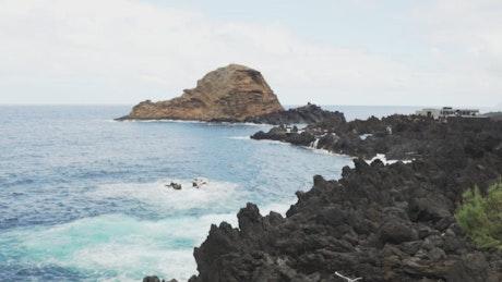 Volcanic rocks on the beach coast