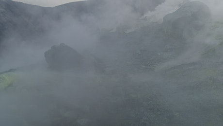 Volcano releasing smoke from the ground