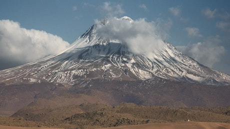Volcano with snow at the peak