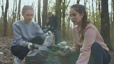 Volunteers collecting bottles