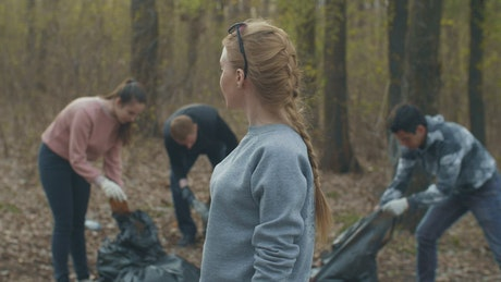 Volunteers recycling in the forest