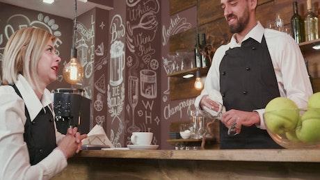 Waitress talking to a bartender