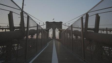 Walking across the empty Brooklyn bridge