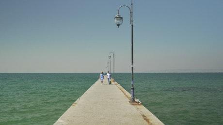 Walking along a concrete pier