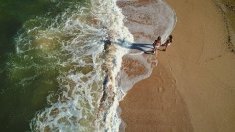 Walking along the ocean waves, top shot