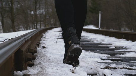 Walking over an old railway tracks in the winter