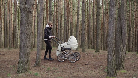 Walking with her baby in the woods
