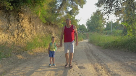 Walking with his Grandfather