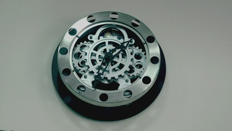 Wall clock with visible nuts