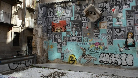 Wall with portraits and graffiti