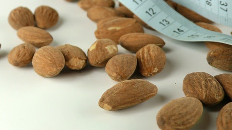 Walnuts and a blue measuring tape