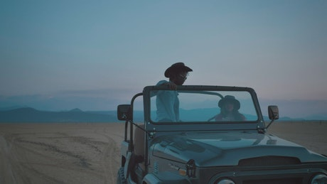 Wanderlusts traveling in a Jeep make a stop