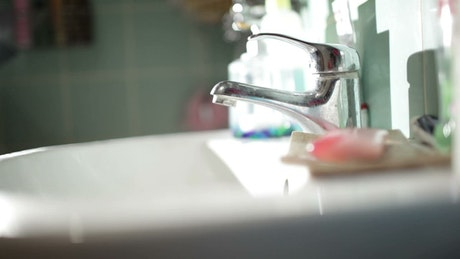 Washing hands with hot water