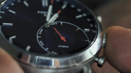 Watch on a man's wrist in a very close shot