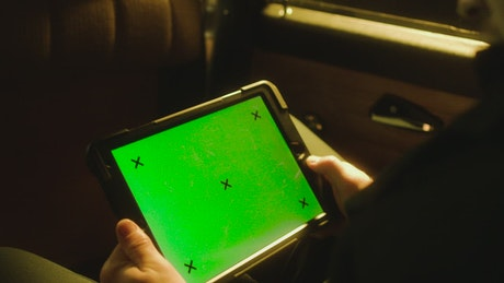 Watching a tablet in a car