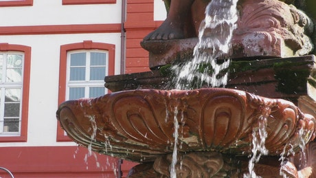 Water falling into a fountain in detail