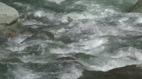 Water flowing down the river in slow motion