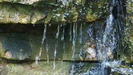 Water running off rocks
