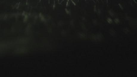 Water spinning against a dark background