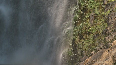 Waterfall and rocks in slow motion