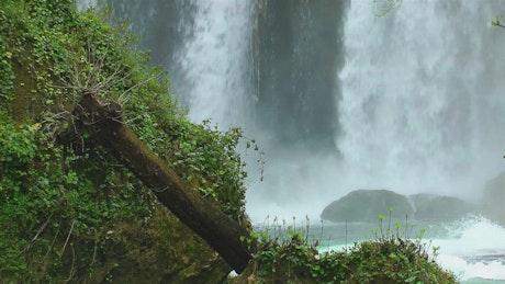 Waterfall behind the rocks