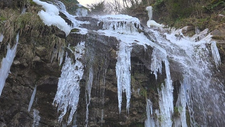 Waterfall on rock with icicles