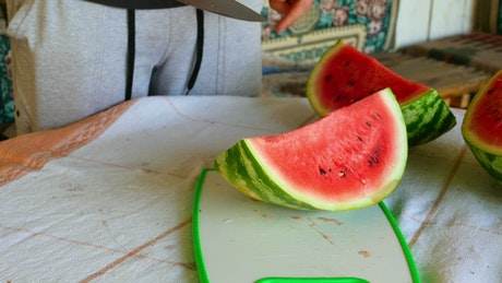 Watermelon being cut by knife