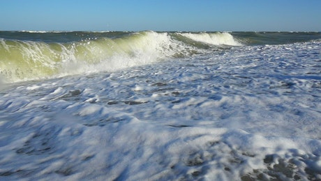 Wave of the sea breaking on the shore
