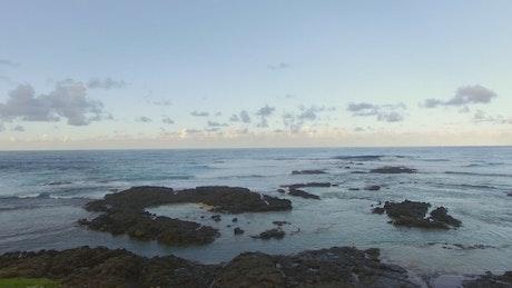 Waves along a volcanic coastline