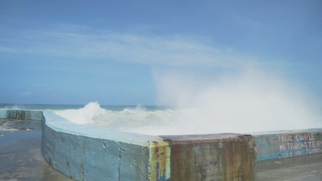 Waves breaking against a coastal wall