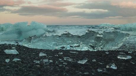 Waves breaking over ice in the ocean shore