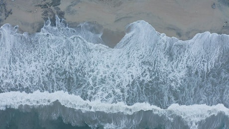 Waves crash on the shore