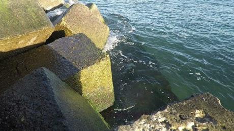Waves crashing at the breakwater