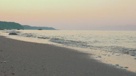 Waves washing up against a clean beach