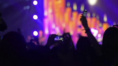Waving phones at a concert