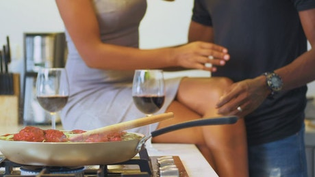 Wedding couple sharing a romantic moment in a kitchen
