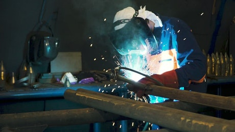 Welding by hand in a workshop