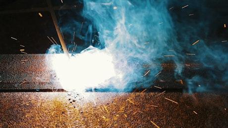 Welding metal with an industrial welding machine